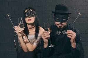 The Christmas bash - A couple wearing masks at a party